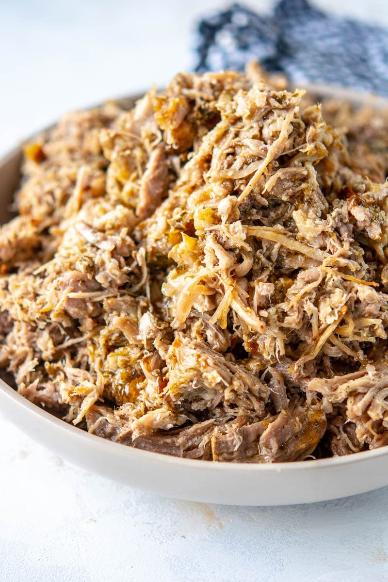 slow cooker cuban pork shredded in a white bowl