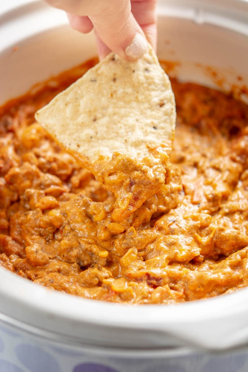 chili cheese dip with a tortilla chip