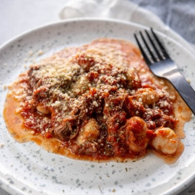 beef ragu on a white plate with fork