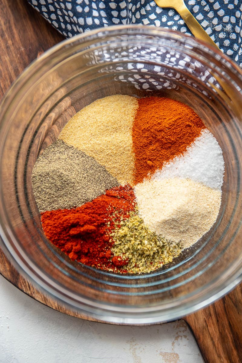 ingredients for cajun seasoning in a glass bowl