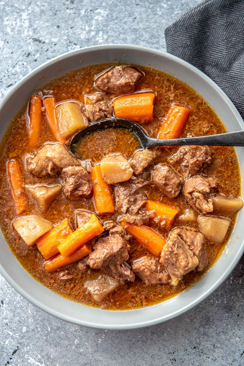 beef stew in bowl with spoon