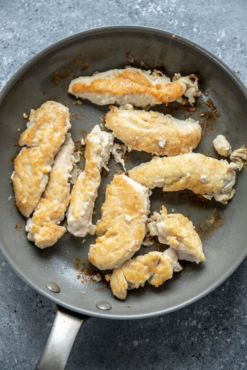 browned chicken in a skillet