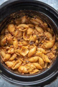 taco pasta in a black slow cooker