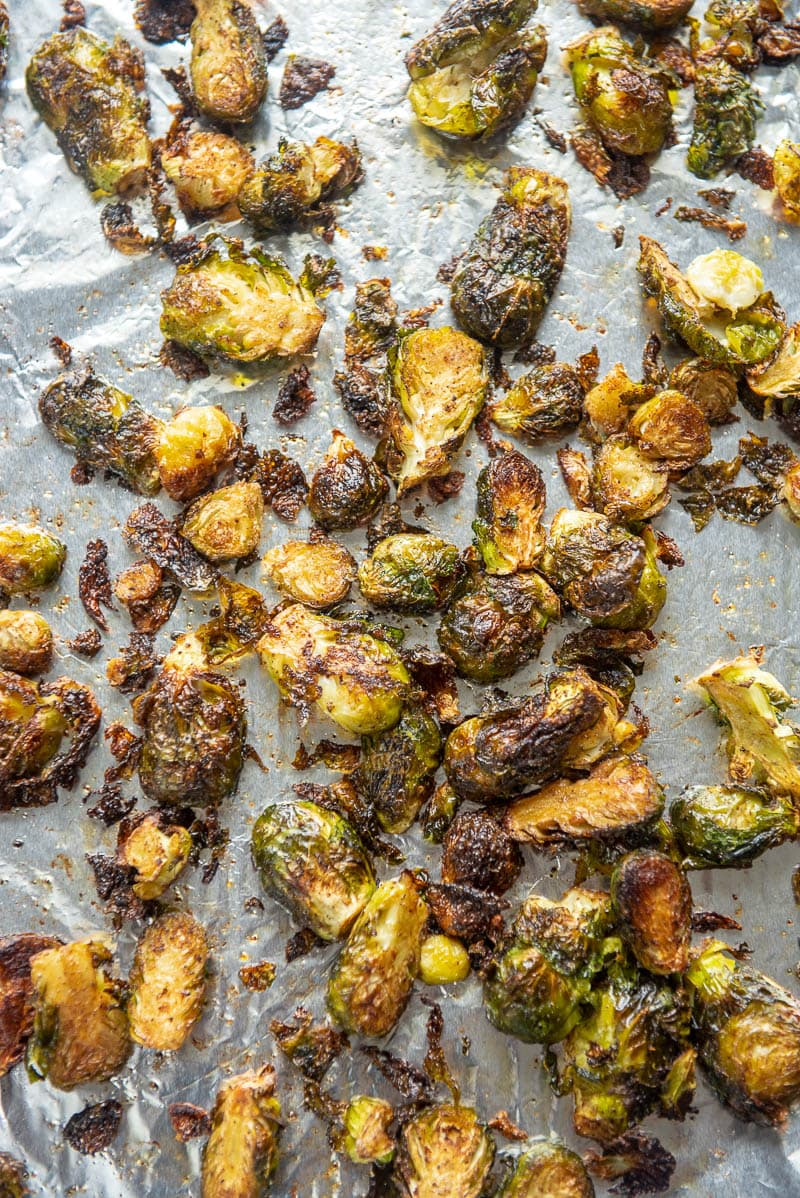 baked spicy brussels sprouts on a baking sheet