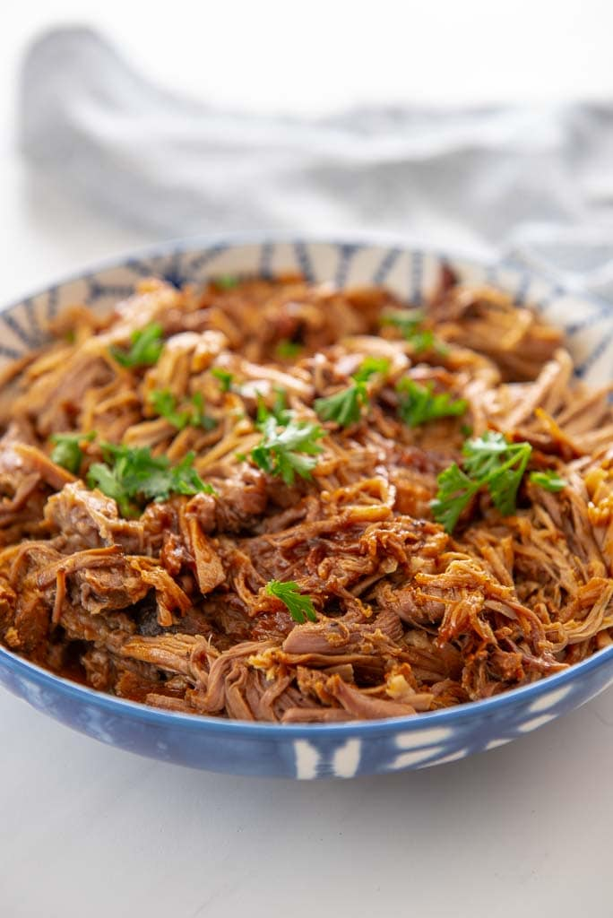 pulled pork in a blue bowl