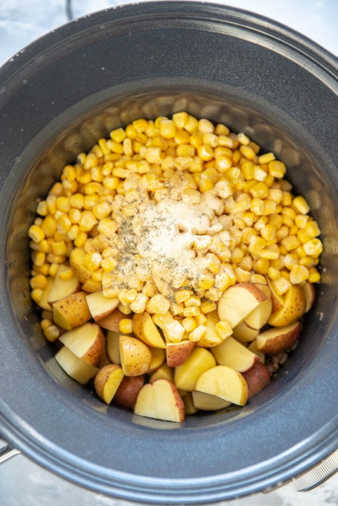 corn and potatoes in round slow cooker