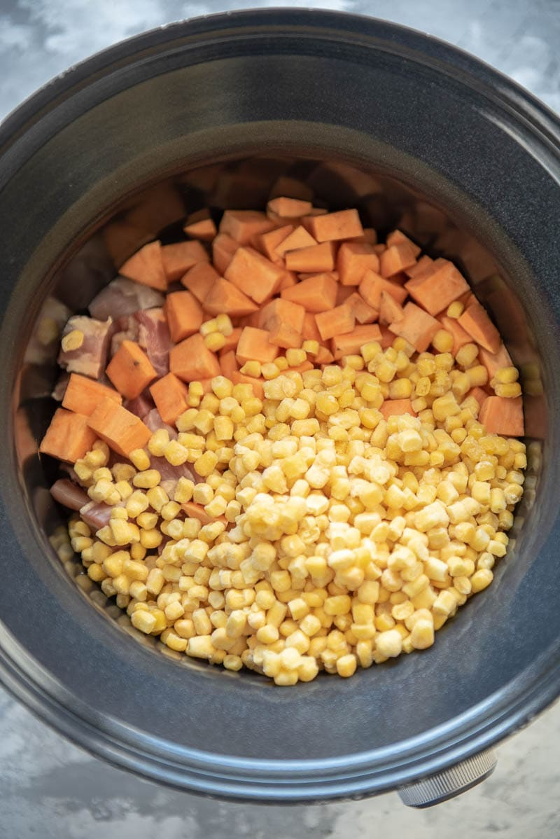ingredients for chicken and sweet potato chowder in a slow cooker