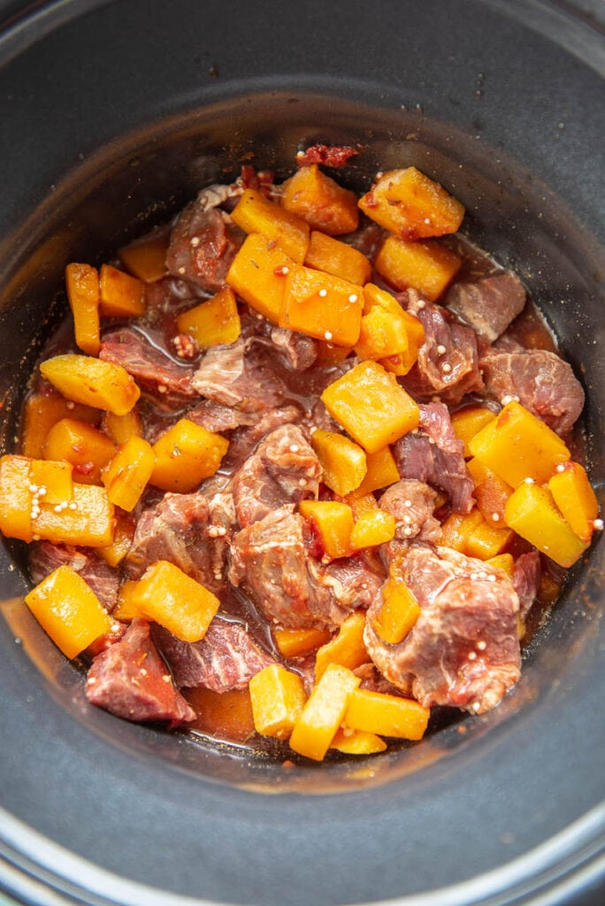 stew meat and butternut squash in a slow cooker