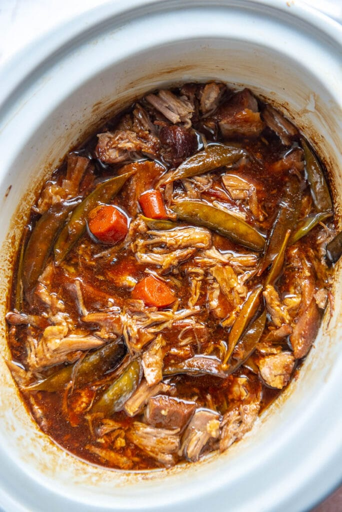 cooked ginger pork in a slow cooker