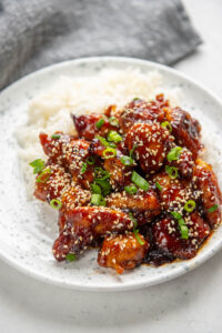 general tso chicken and rice on a plate