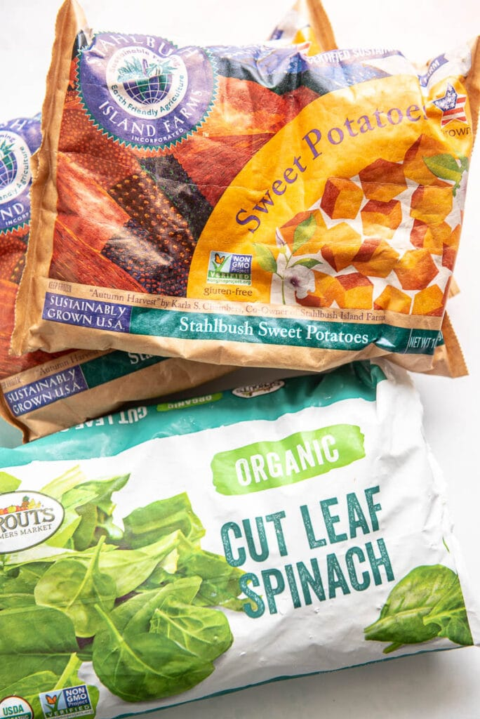 bags of spinach and sweet potatoes