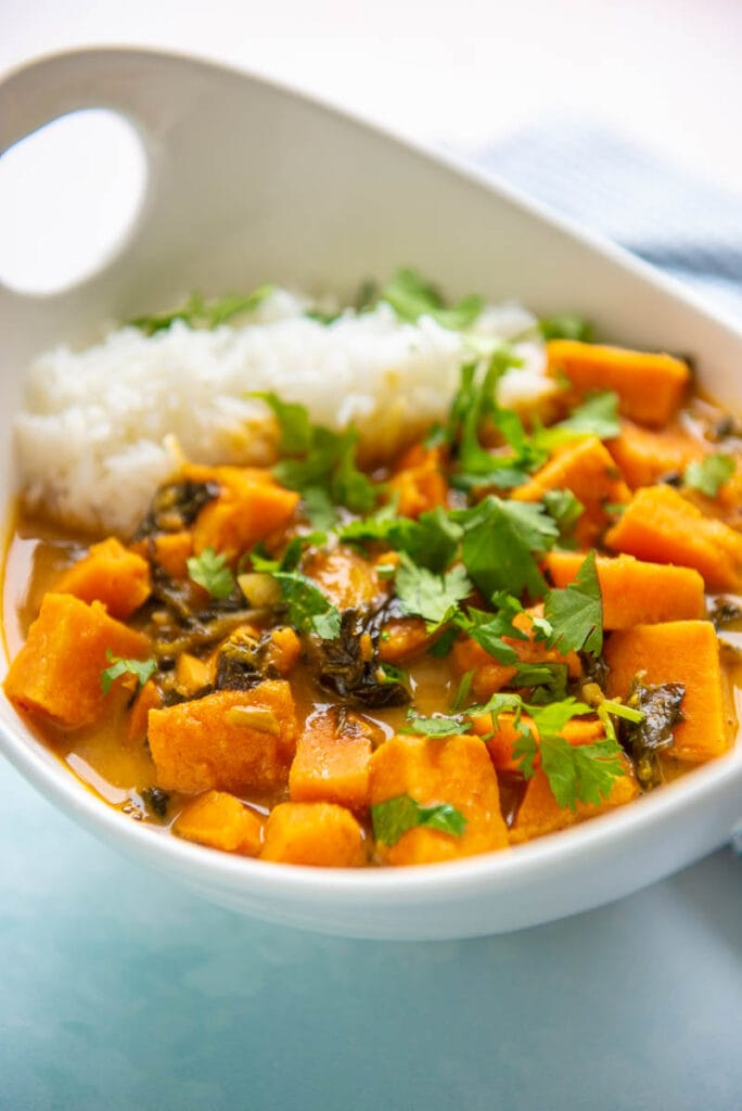 closeup of sweet potato curry in a white bowl