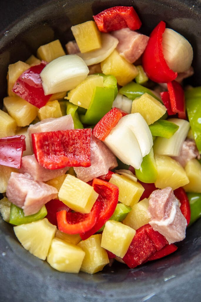 chopped veggies for sweet and sour pork in a slow cooker